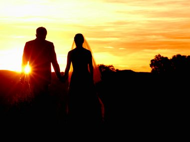 wedding photography of bride and groom walking towards sunset in Tamworth