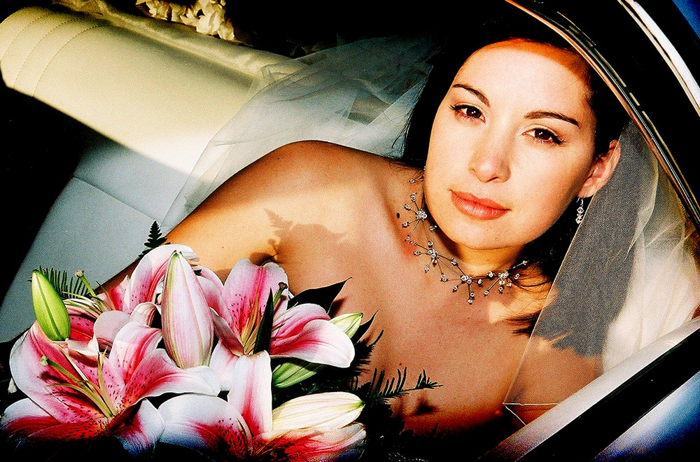 Photography of bride looking out window of car Nambucca Heads