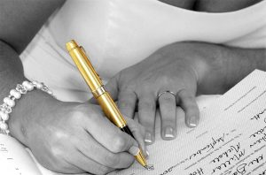 Bride signing register for wedding photography Coffs Harbour