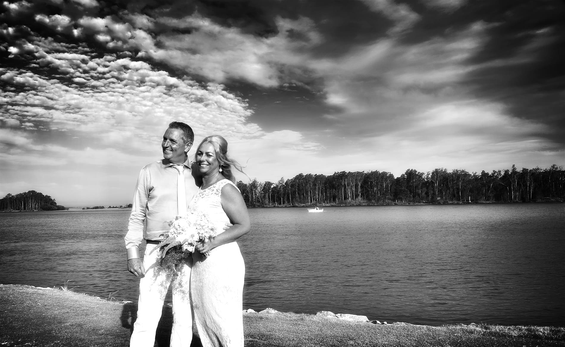 Bride and Groom standing near Nambucca River