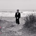 page boy walking from beach