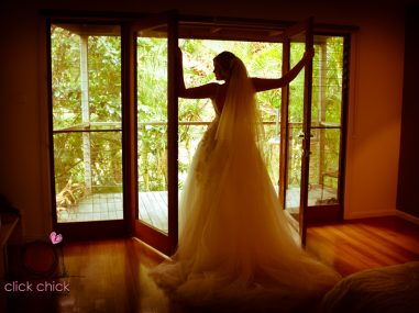 bride standing at windows Breakfree Annuka Beach Resort