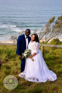 bride and groom standing at Valla Beach