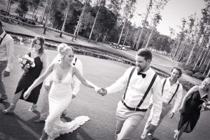 bride and groom walking at Bonville Golf Club